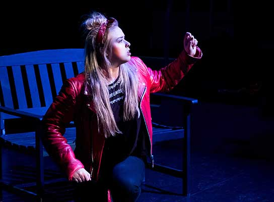 Female student performing on stage at Paston College
