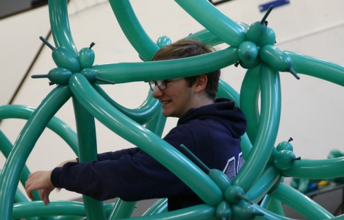 A Paston College student helping put together the giant 3D fractal Pic Credit Paston College
