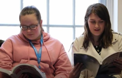 Jessica and Lauren reading text books at Paston