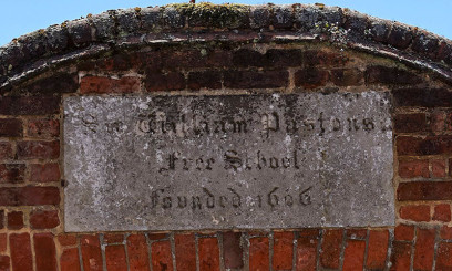Historic sign showing when Paston Free School was founded