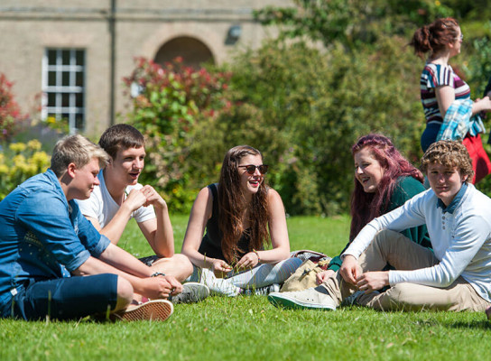 Paston students chatting on campus lawns