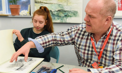Tutor supporting student in Paston college classroom